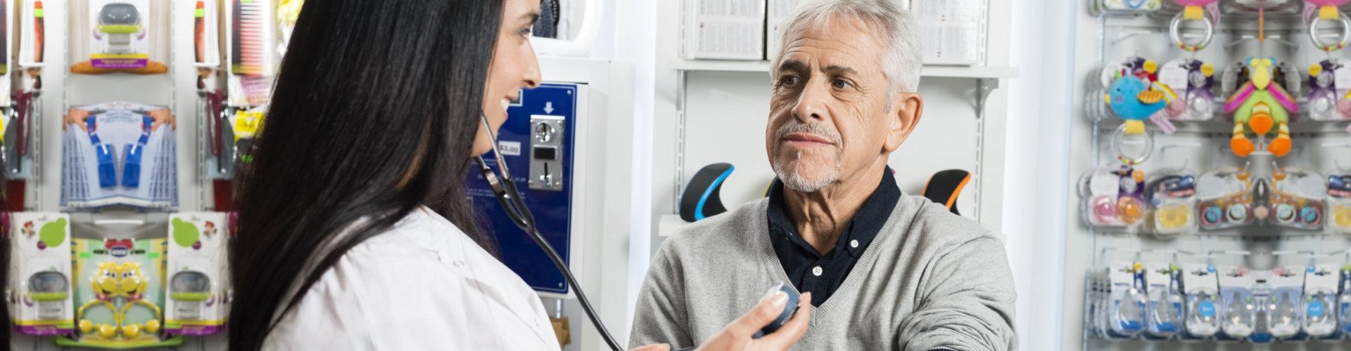senior man getting his blood pressure tested
